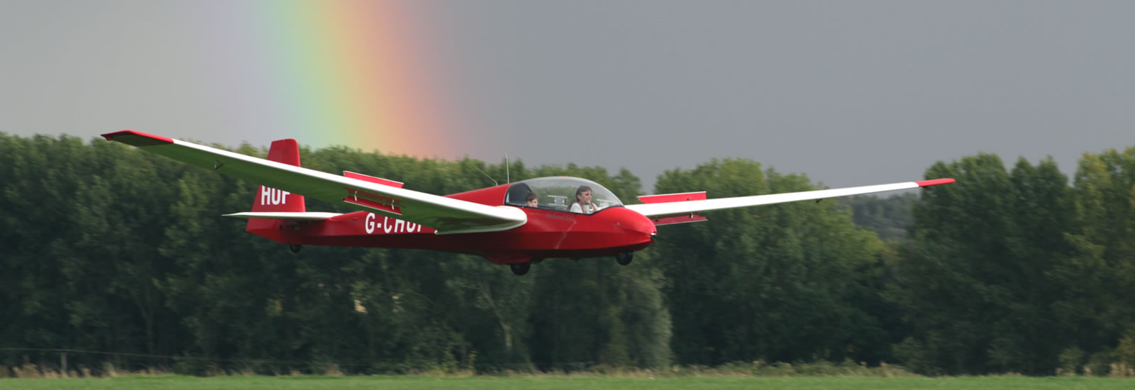 Welland Gliding Club Glider Landing With Rainbow Behind