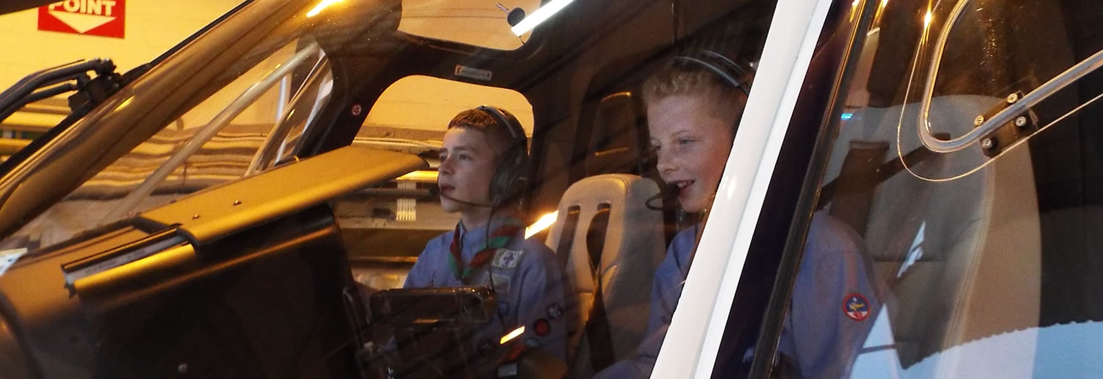 At the Controls of a Sloane Helicopter